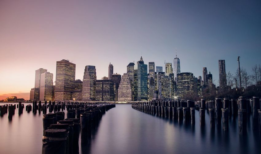 A 5 minute long exposure of New York taken at dusk in winter. Architecture Building Exterior Built_Structure City Cityscape Clear Sky Day Illuminated Modern No People Outdoors Sky Skyscraper Travel Destinations Urban Skyline Water Waterfront Fresh On Market 2017
