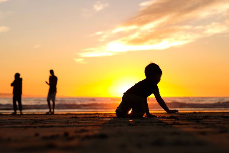 Sunset Silhouette Beach Real People Childhood Sea Leisure Activity