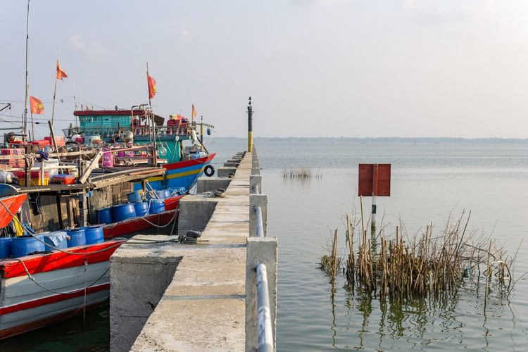 One boat one moorage. Clear Sky Huế Tranquility Vietnam Bay Boat Countryside Dock Estuary Fence Fishing Boat Fishing Industry Lake Moored Nature Nautical Vessel No People Outdoors Pier Port Tranquil Scene Walkway Water Wharf Wooden Post