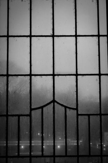 Window Looking Out Of The Window Dirty Window Dirty Focus On Foreground Architecture Black & White Blackandwhite Beauty In Nature Train Station Railway Station Black And White