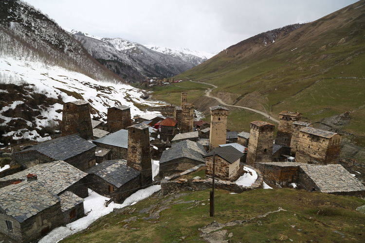 Georgia Mestia/town In Svaneti/Georgia Mountain Architecture Sky Landscape Built Structure Building Nature Environment Building Exterior No People Cold Temperature Day Beauty In Nature Snow House Scenics - Nature Winter Outdoors Village Mountain Range