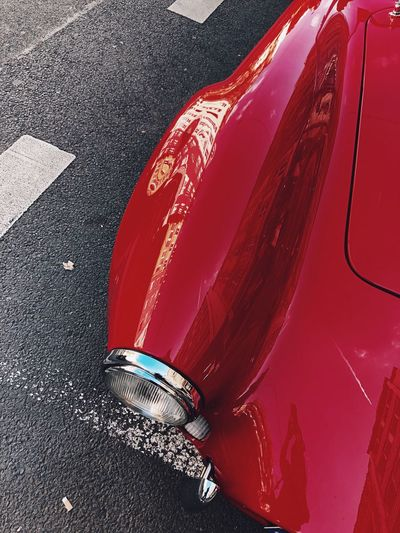 High angle view of red car on road