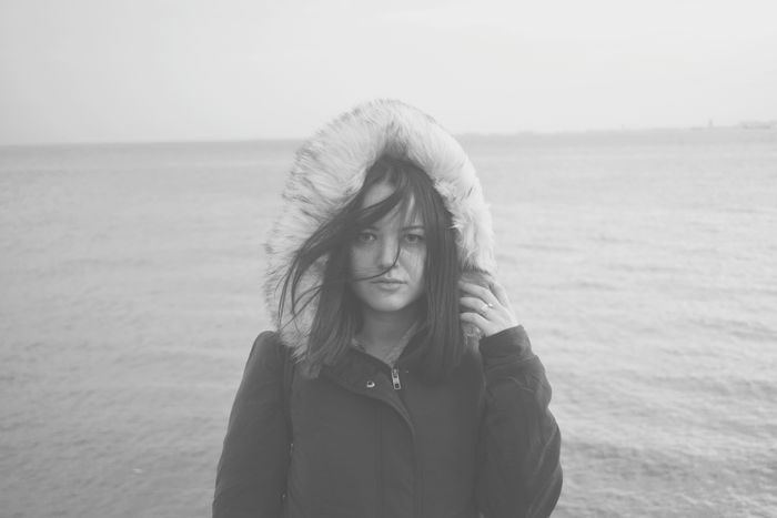 Sea Outdoors Front View One Woman Only Portrait Adults Only Wind Nature One Young Woman Only Day Photography Themes Focus On Details Details In Close Up Fashion Lifestyles The Street Photographer - 2017 EyeEm Awards The Calm Photography Movement People Portrait People Of EyeEm The Portraitist - 2017 EyeEm Awards People Photography Winter Coat Casual Clothing Hood - Clothing Live For The Story