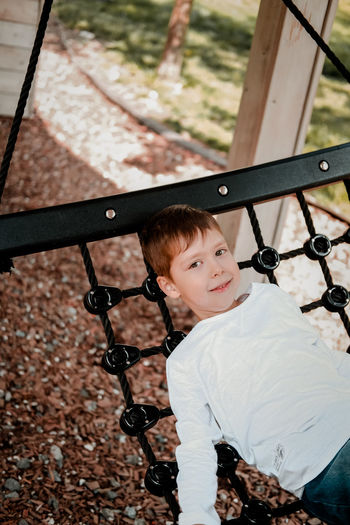 Boy is resting in the park, lies
