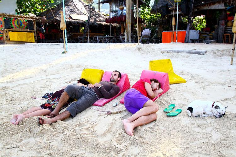 Two men sitting on beach