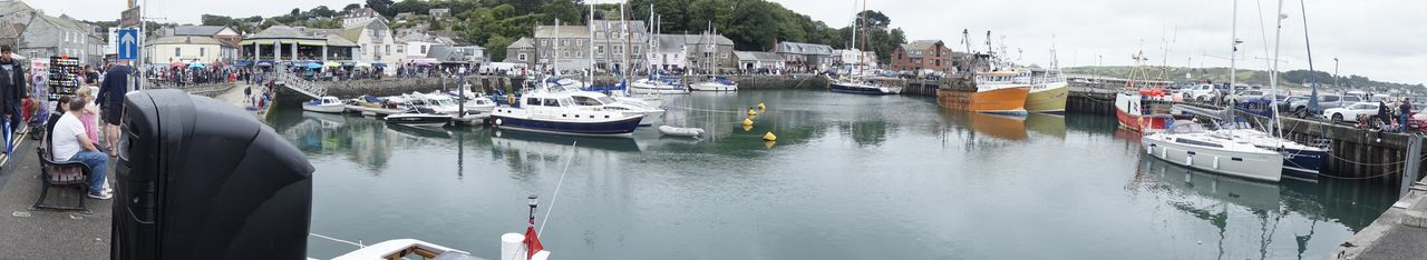 9457 Cars Padstow People Watching Trees Water Reflections Adult Adults Only Architecture Boats Building Exterior Built Structure Cornwall Day Harbor Moored Nautical Vessel One Person Outdoors People People Photography Sails Travel Destinations Water Water_collection