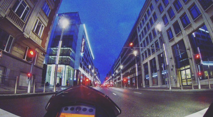 Riding into the city of Brussels on a motorcycle around dawn Architecture Blue Building Exterior Built Structure Car City Illuminated Land Vehicle Mode Of Transport Night No People Outdoors Road Sky Transportation