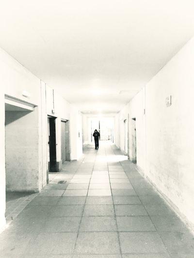 Full Length Of Person Walking Through Corridor