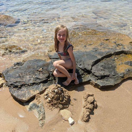 Full length portrait of girl on beach
