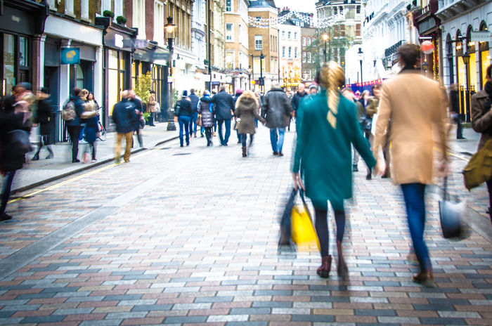 Couple holding hands and shopping bags on high street Britain Couple Economy High Street Holding Hands Shops Tourist Blurred Motion EyeEmNewHere Consumerism England High Street Shopping Motion Outdoors Pedestrian Purchasing Shopping Time Spending Street Tourism Uk Walking Shopping