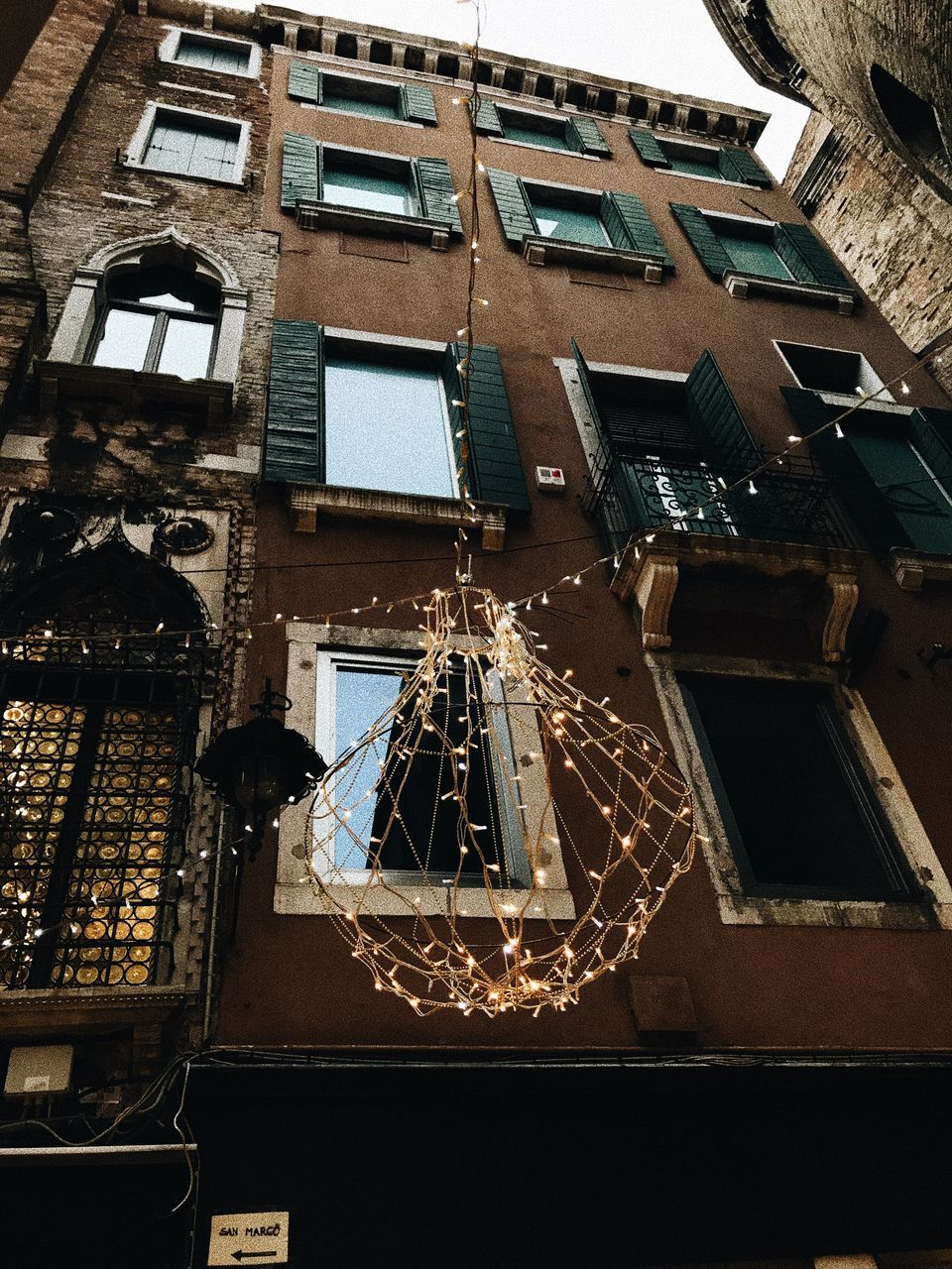 built structure, architecture, building exterior, low angle view, building, no people, window, residential district, illuminated, outdoors, night, lighting equipment, nature, city, staircase, balcony, fire escape, old, reflection, apartment