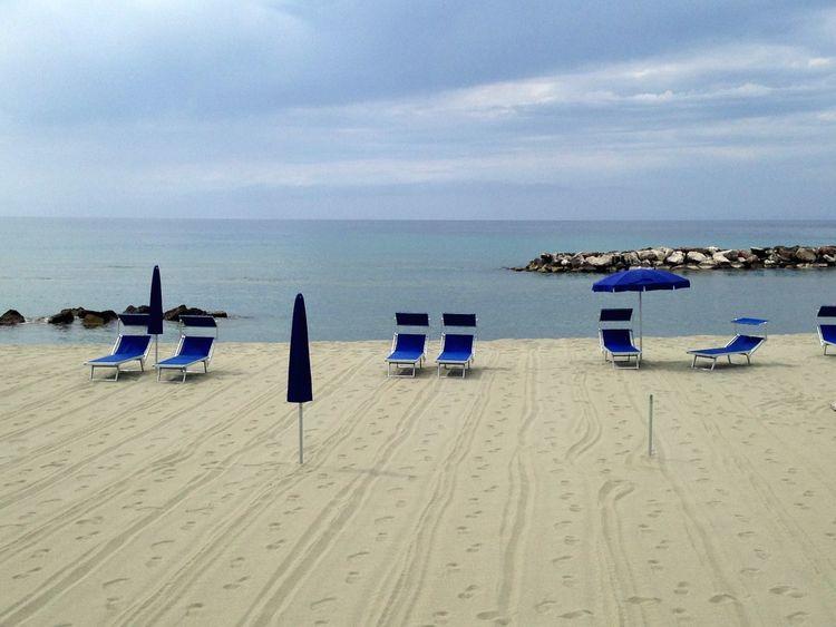 Beach on Ischia Italian Beachlife Italien Italy Blue Loungechairs Italian Beach Ischia Forio D'Ischia Beach Land Sea Water Sand Sky Horizon Over Water Horizon Chair Tranquil Scene Holiday Absence