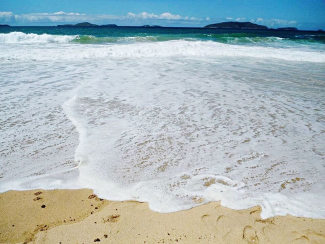 Beach Sand Sea Water Surf Shore Scenics Tourism Tranquil Scene Tranquility Vacations Coastline Wave Travel Destinations Beauty In Nature Nature Tide Travel Non-urban Scene Summer