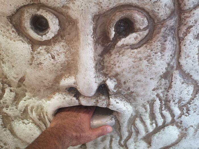 Close-up of human hand holding ice cream
