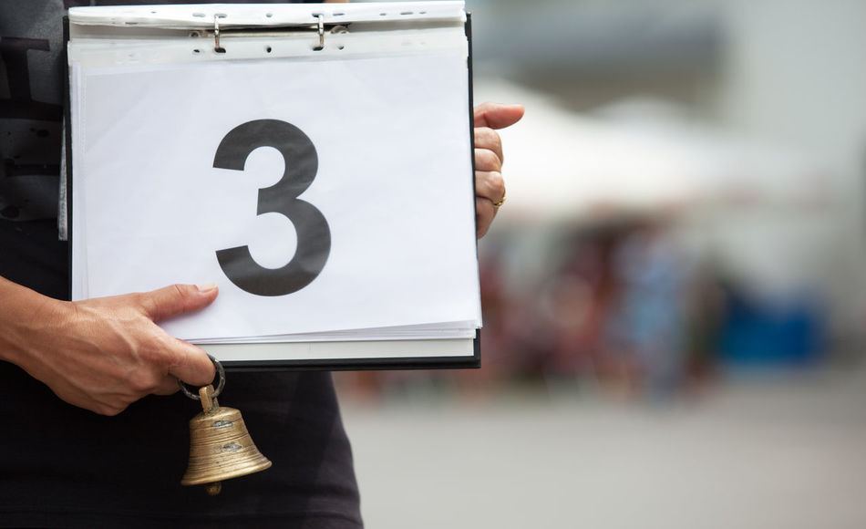 Number three. 3 Bell Bronze Icon Mark Numerical Referee Sign Close-up Competition Competition Day Competitive Sport Evaluation Hand Holding Judge Mathematics Number Numeral Numeric Position Selective Focus Sport Symbol Three