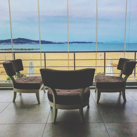 Chair Table Sea Indoors  Empty Window No People Absence Furniture Day Horizon Over Water Sky Water Seat Nature