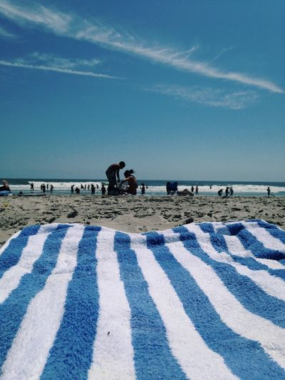 Striped towel on shore at beach