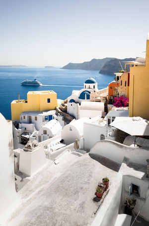 IA Santorini, Greece Architecture Building Building Exterior Built Structure Clear Sky Day Land Mountain Mountain Range Nature No People Outdoors Residential District Scenics - Nature Sea Sky Sunlight Town Water