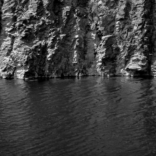 Water Waterfront Nature No People Tranquility Rock Formation Beauty In Nature Cliff Scenics - Nature Sea Tranquil Scene Lakeside Stone Wall Rock Wall Texture Water Surface