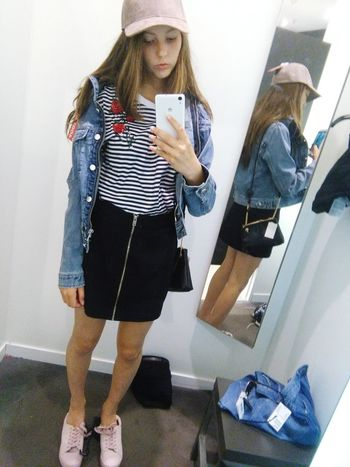 Mobile Phone Smart Phone Girl Indoors  One Person Lifestyles Girl Power Young Women Wireless Technology Only Girl Alone Teenager People Love ♥ Mammal Human Body Part Skirt Flowers In The Shop  Close-up