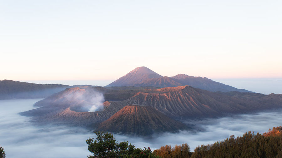 Panoramic view of volcanic mountain against sky during sunset