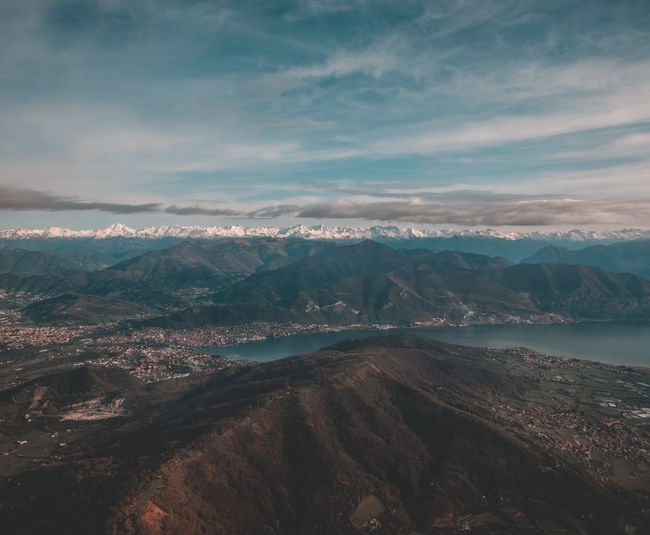 City Plane View Skyline Beauty In Nature Cloud - Sky Clouds Clounds And Sky Day Environment Idyllic Lake Landscape Mountain Mountain Range Mountains Nature No People Non-urban Scene Outdoors Remote Scenics - Nature Sky Tranquil Scene Tranquility Water
