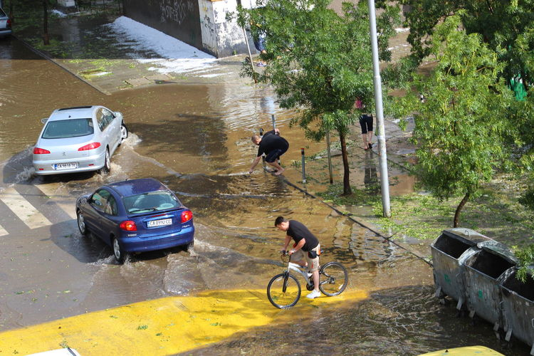 After Storm Bicycle Cars Flood Hailstorm How Do We Build The World? Men Mode Of Transport No Escape No Exit Real People Transportation Urban Showcase March The Photojournalist - 2016 EyeEm Awards