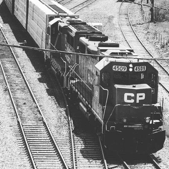 Railroad locomotive series: CP Black And White Photography CP Rail Locomotive Engine Transportation Mode Of Transportation Rail Transportation Day Track No People Railroad Track Sunlight Public Transportation Train - Vehicle Railroad Station Train Shadow Outdoors Text Travel