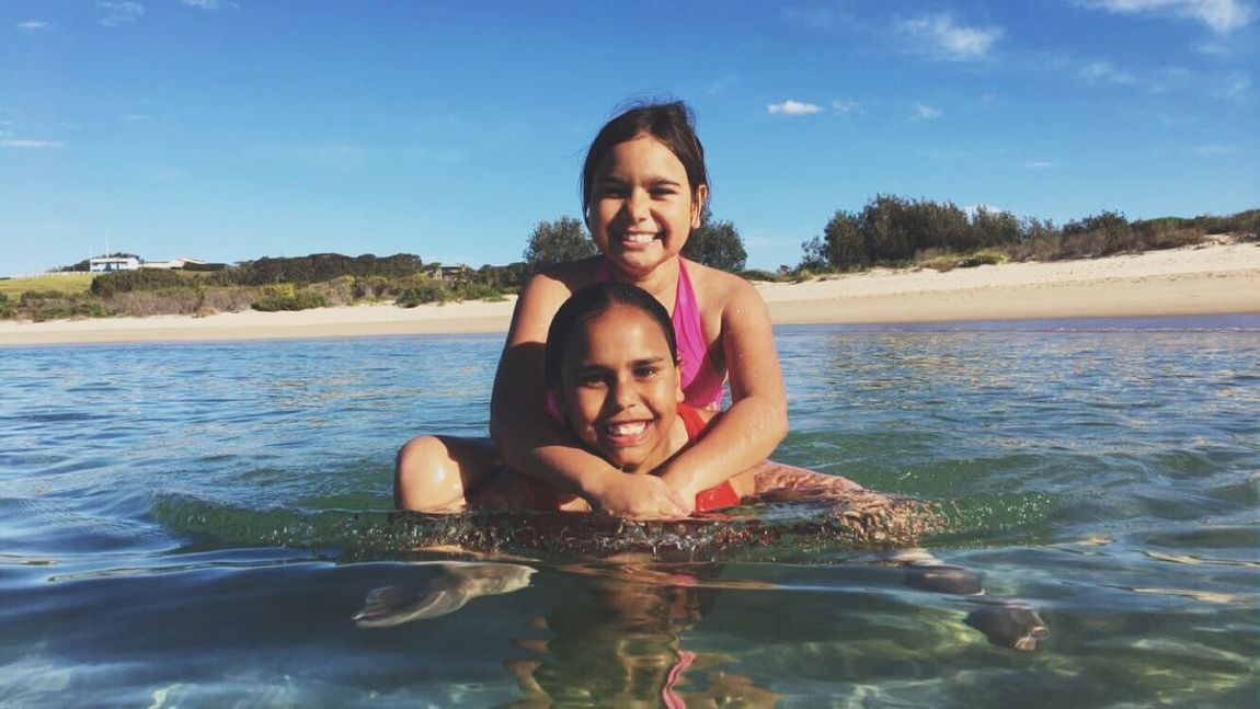 Family Indigenous  Australia Native Aboriginal Looking At Camera Portrait Smiling Happiness Togetherness Water Family With One Child Bonding Leisure Activity Real People Family Fun Cheerful Childhood