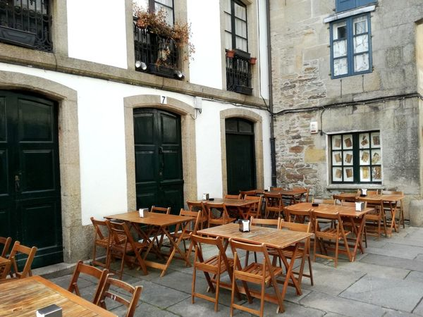 Chair Window Table Architecture Building Exterior Built Structure No People Day Sidewalk Cafe Cafe Outdoors Furniture Galicia, Spain Santiago De Compostela Street Photograpy Restaurant View Siesta Time Terrace Scene Spanish Style Spanish Culture