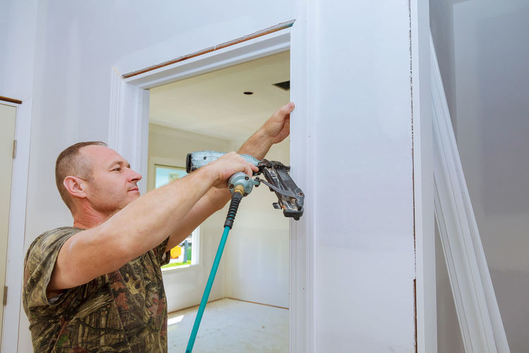 Man Drilling Door At Home