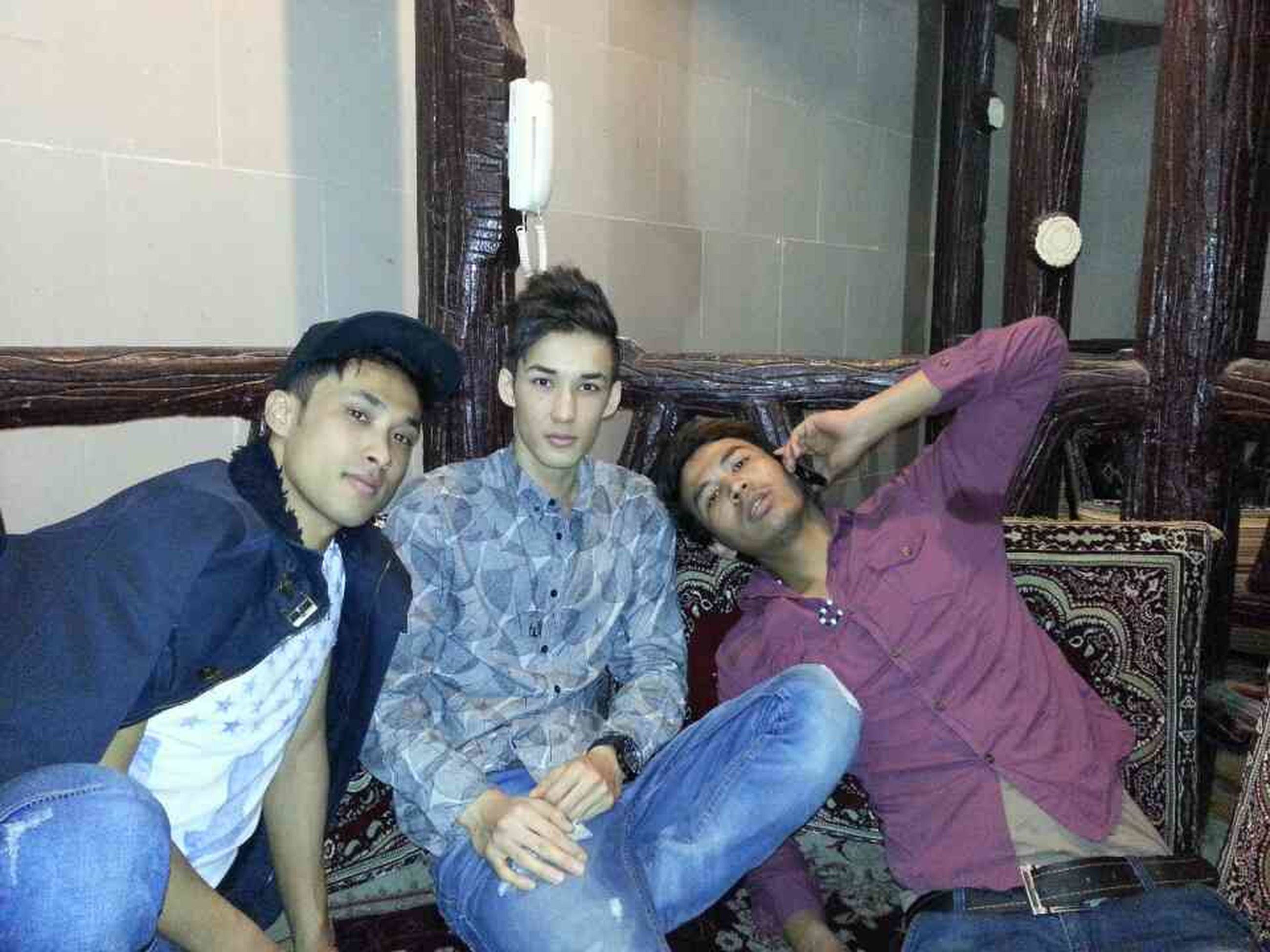person, lifestyles, togetherness, casual clothing, bonding, leisure activity, indoors, love, young adult, young men, happiness, family, sitting, boys, childhood, front view, smiling