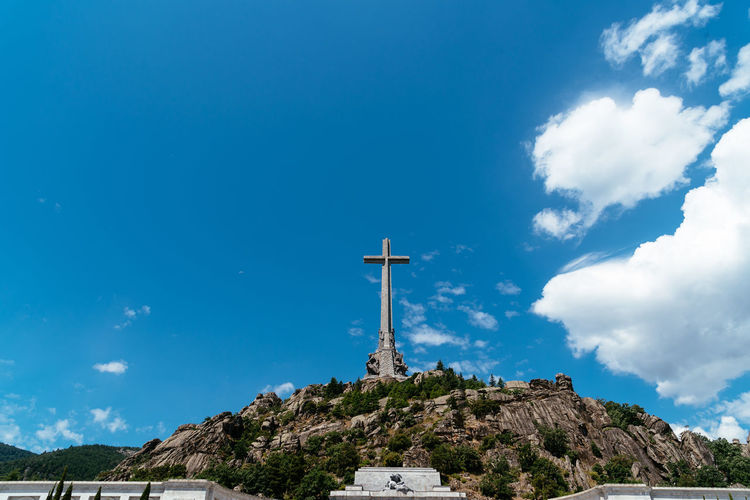 Basilica and big cross in the Valley of The Fallen in Madrid Basilica Cross El Escorial Madrid SPAIN Spanish Civil War Tomb Architecture Belief Building Exterior Built Structure Cloud - Sky Cross Europe Exhumation Franco Low Angle View Nature Outdoors Place Of Worship Politics And Government Religion Sky Spirituality Valley Of The Fallen