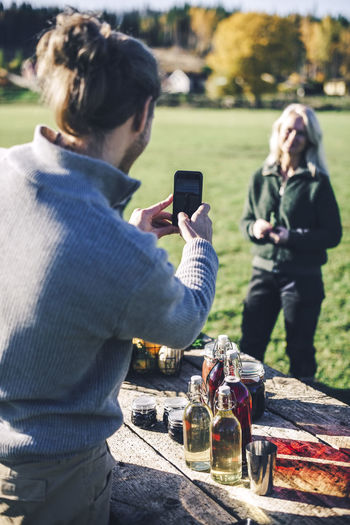 People photographing on mobile phone