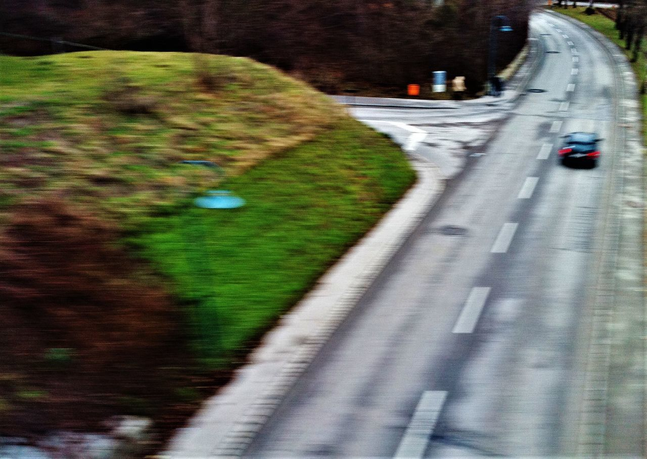 transportation, road, motion, blurred motion, car, the way forward, speed, land vehicle, high angle view, day, no people, outdoors, grass, nature