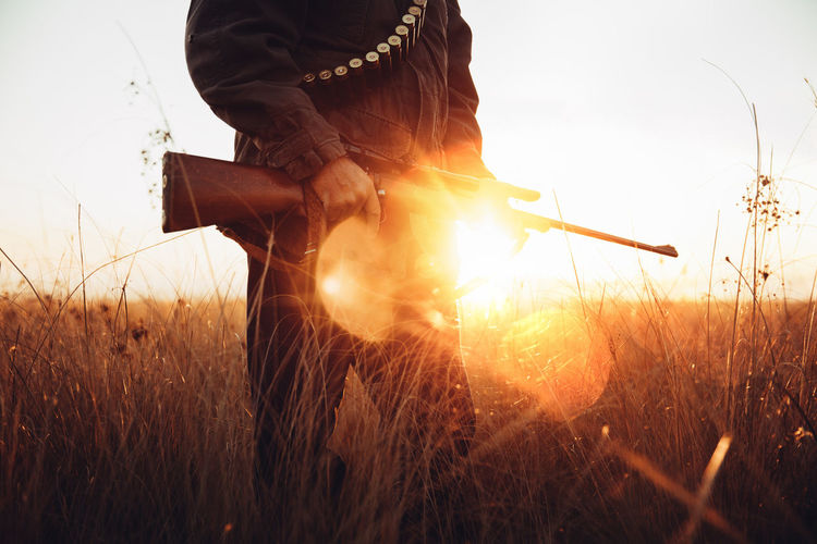 Agriculture Field Gun Hunter Hunting Leisure Activity Lens Flare Lifestyle Man Mature Meat Nature Outdoors People Pointing Prey Rural Scene Skill  Sniper Sunbeam Sunflare Sunlight Sunrise Sunset Weapon