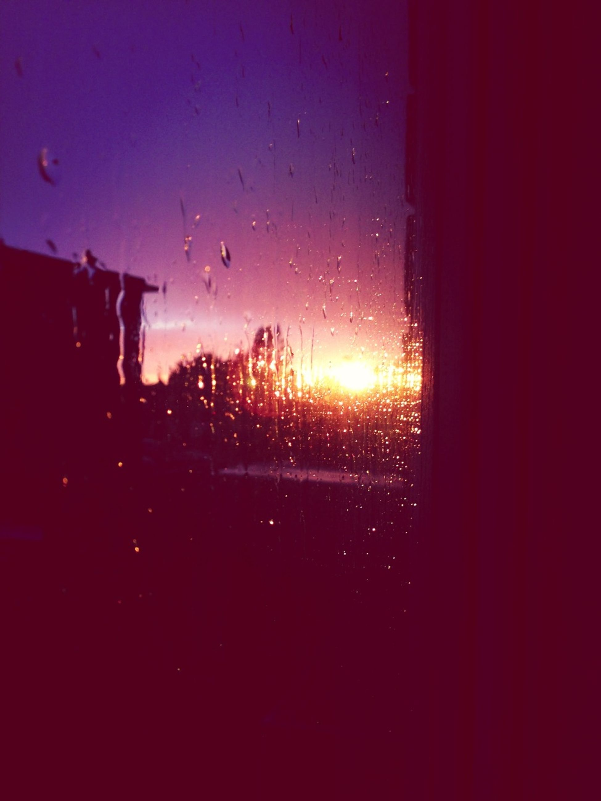 window, transparent, glass - material, sunset, sky, drop, silhouette, indoors, wet, sun, weather, water, nature, rain, no people, dark, glass, beauty in nature, scenics, season