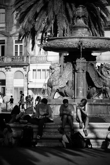 Tourist season Adult Architecture City Day Fountain Large Group Of People Light And Shadow Men Monochrome Photography Outdoors People Person Place Of Worship Real People Religion Sculpture Spirituality Statue Tourist Vertical Water Women Writing