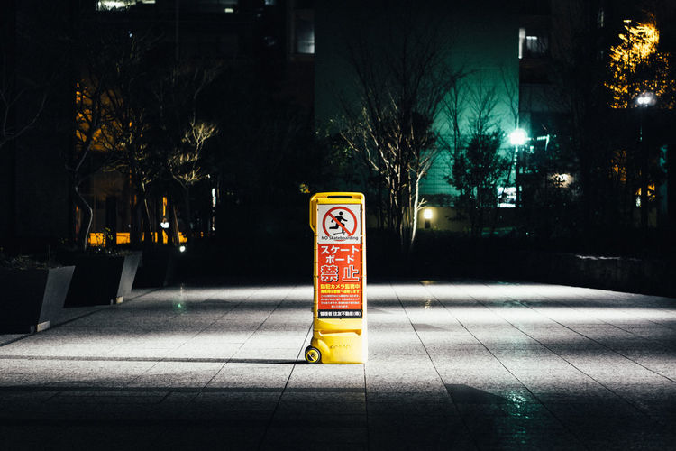 Architecture Building Exterior Built Structure City Communication Footpath Illuminated Night No People Outdoors Plant Road Safety Sidewalk Sign Street Text Transportation Tree Western Script #urbanana: The Urban Playground HUAWEI Photo Award: After Dark EyeEmNewHere