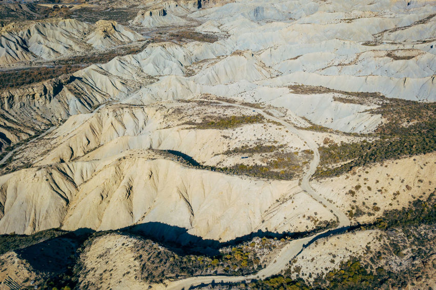 DJI X Eyeem Desert Wild West Aerial View Arid Climate Beauty In Nature Day Desert Landscape Extreme Terrain Geology Landscape Mountain Nature No People Outdoors Physical Geography Sand Scenics Tabernas Desert Textured  Travel Destinations Western Wilderness Area
