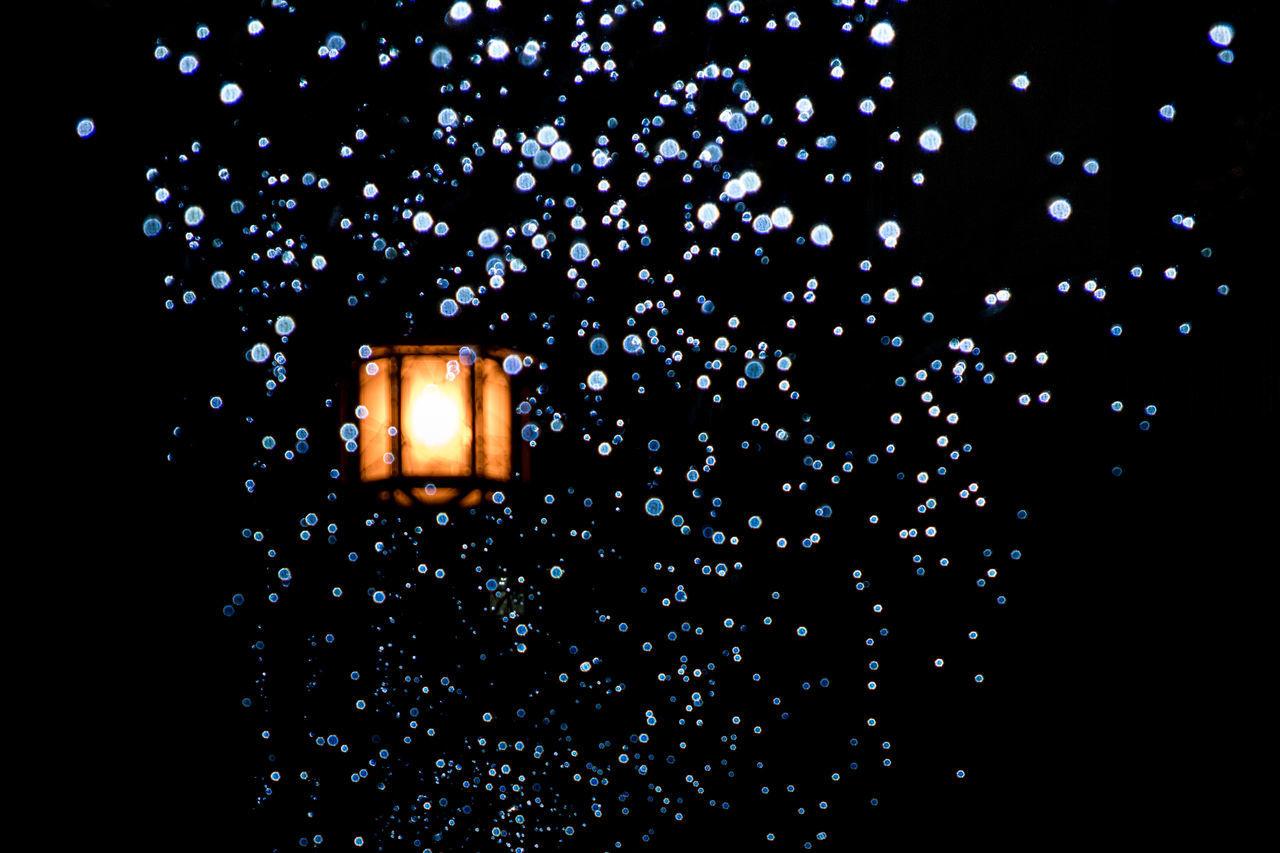 Illuminated lamp in rain
