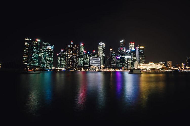 Illuminated city at waterfront