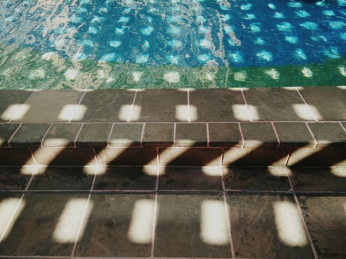 High Angle View Of Sunlight Falling On Poolside