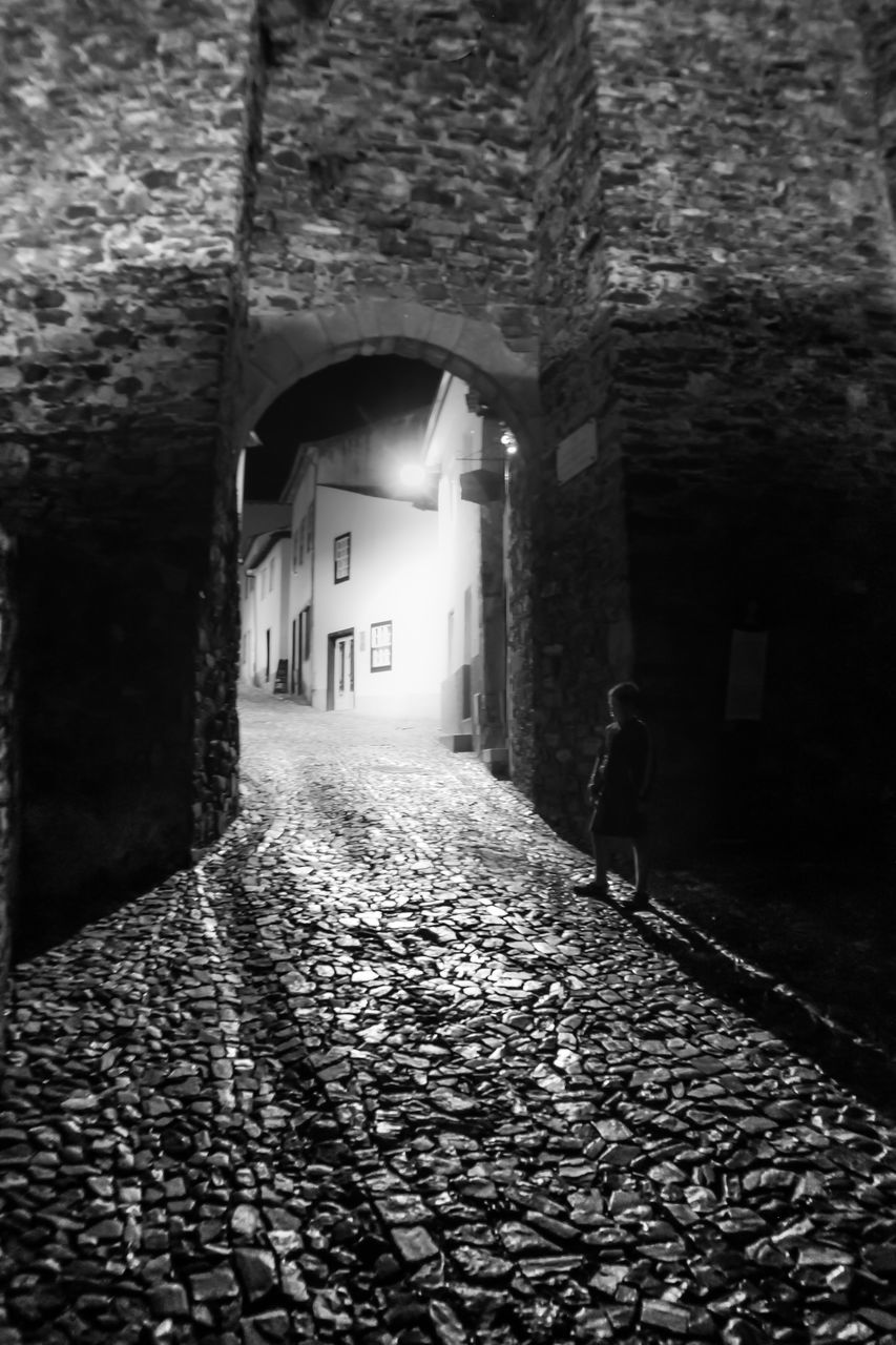 architecture, built structure, the way forward, arch, cobblestone, building exterior, day, one person, illuminated, real people, outdoors