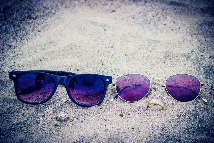 Sunglasses Close-up Outdoors Sand Beach No People Trendy Day Rings Swag Coupleshot Sunglasses Blue Close-up Sand Outdoors Day Beach No People Trendy Goggles