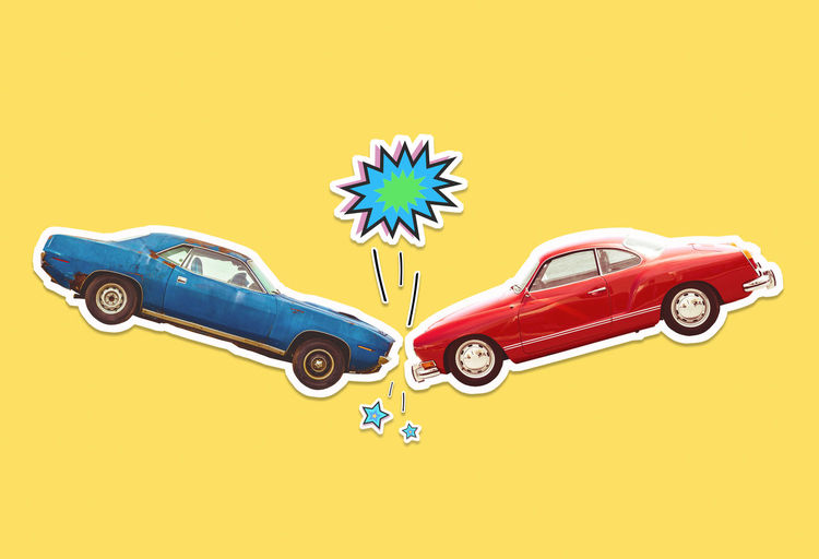 Toy car against yellow background