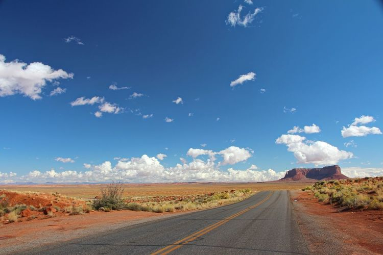Beautiful monument valley Sky Road Transportation Cloud - Sky Direction The Way Forward Landscape Environment Nature Scenics - Nature Day Tranquil Scene No People Empty Road Tranquility Beauty In Nature Non-urban Scene vanishing point Land Road Marking Diminishing Perspective Outdoors Dividing Line