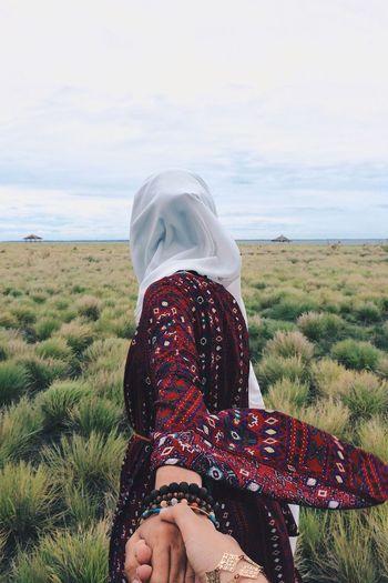 Woman On Field Against Sea