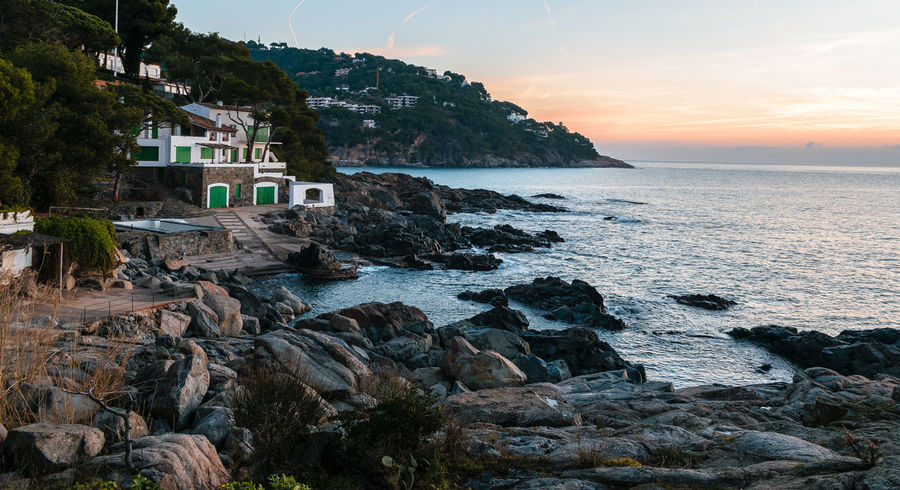 Nice beach house in Costa Brava, Catalonia. EyeEmNewHere Architecture Beach Beauty In Nature Building Exterior Built Structure Cliff Day Horizon Over Water Mountain Nature No People Outdoors Rock - Object Scenics Sea Sky Sunset Tranquil Scene Tranquility Water