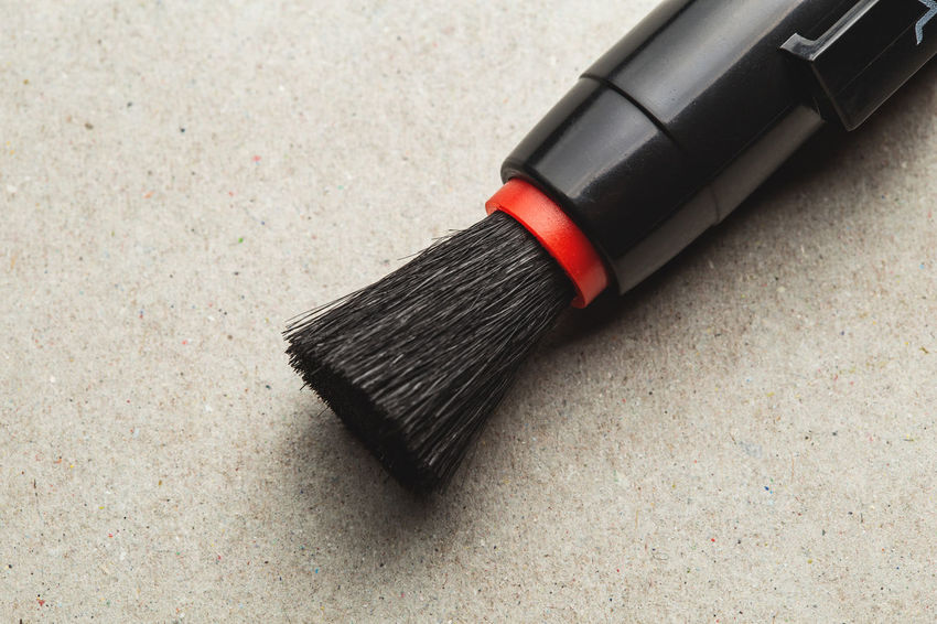 close up view of a camera cleaning brush Black Color High Angle View No People Single Object Close-up Beauty Indoors  Cleaning Brush Still Life Broom Flooring Body Care Brushing Writing Instrument Rubber Focus On Foreground Copy Space Ink Personal Accessory